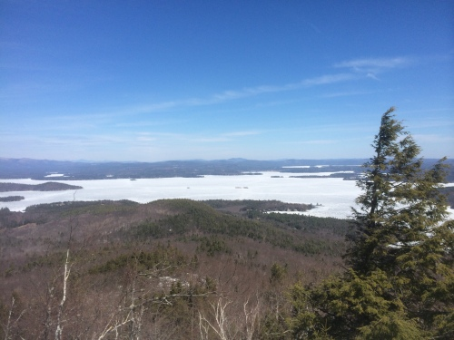 Lake Winnipesaukee still frozen with a white Mount Washington in the clear distance
